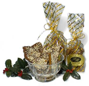 Has To Be Haster's Gourmet English Toffee in various packaging with holly branches